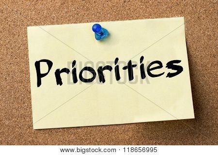 Priorities - Adhesive Label Pinned On Bulletin Board