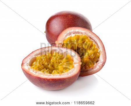 Whole And Half Cut Passion Fruits On White Background