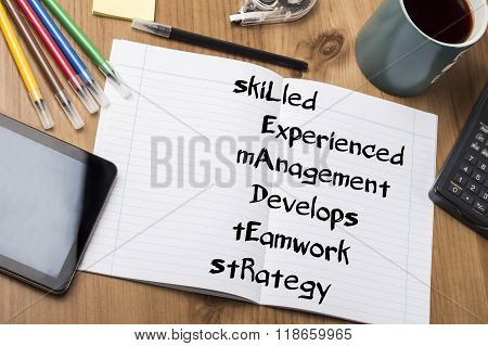 Skilled Experienced Management Develops Teamwork Strategy Leader - Note Pad With Text
