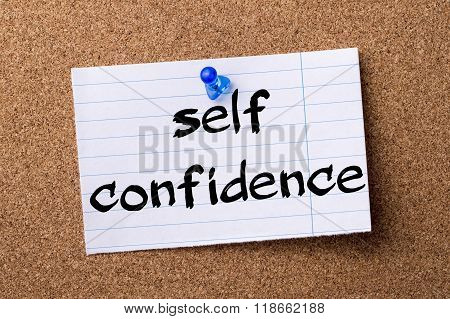 Self Confidence - Teared Note Paper Pinned On Bulletin Board