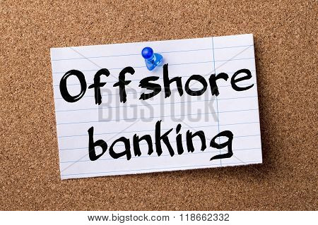 Offshore Banking - Teared Note Paper Pinned On Bulletin Board