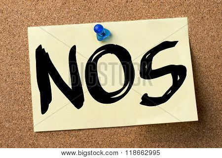 Nos - Adhesive Label Pinned On Bulletin Board