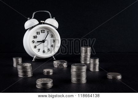 Vintage Clock And Coin Towers On Black