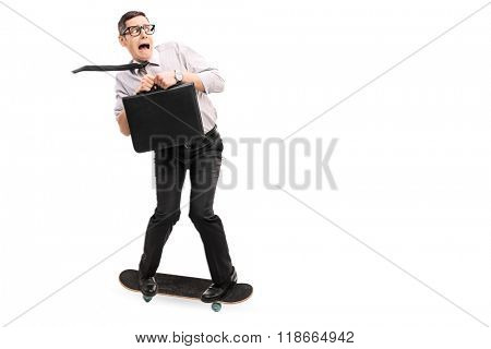 Scared businessman riding a skateboard and moving fast isolated on white background
