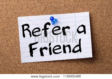 Refer A Friend - Teared Note Paper Pinned On Bulletin Board