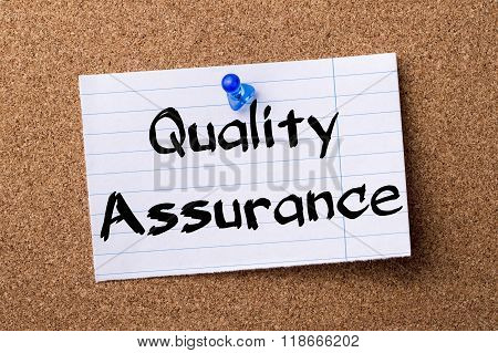 Quality Assurance - Teared Note Paper Pinned On Bulletin Board