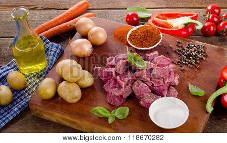 Ingredients For Stew Or Goulash  On A Cutting Board.