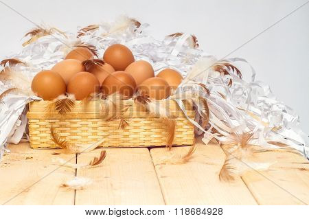 eggs in basket on wooden with white background