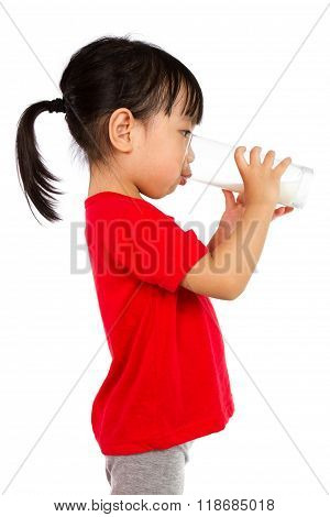 Asian Little Chinese Girl Drinking A Cup Of Milk
