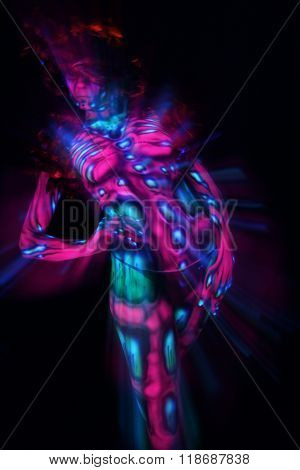 Girl in colorful ultraviolet costume