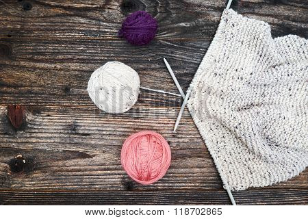 Balls Of Yarn With Knitting Needles