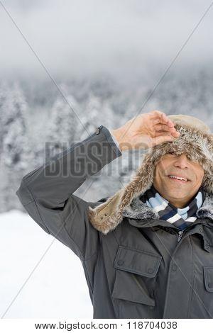 Man peeking through a deerstalker hat