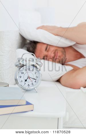 A Irritate Man In His Bed Before Waking Up