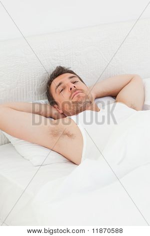 A Relaxed Man In His Bed Before Waking Up