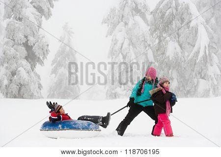 Boy on inflatable toboggan