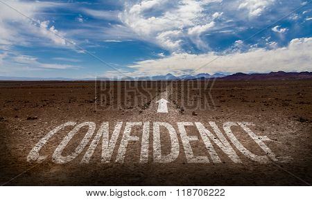 Confidence written on desert road