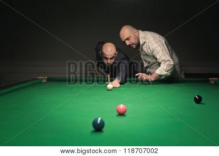 Men playing billiard