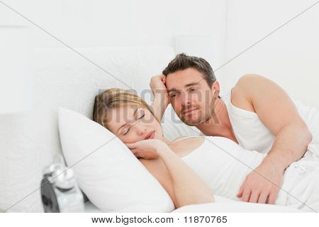 Boyfriend Looking At His Girlfriend Who Is  Sleeping