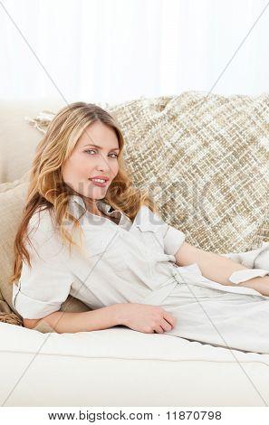 Wonderful Woman Lying Down On Her Sofa
