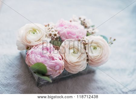 composition of peonies and roses