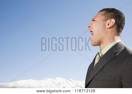 Man shouting near mountains