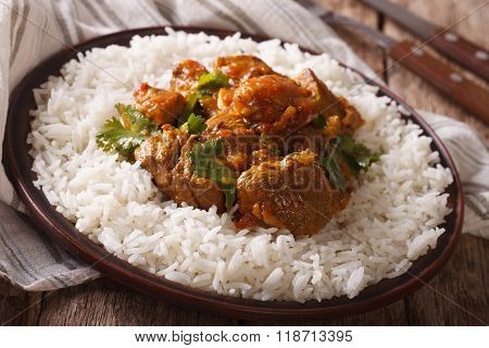Madras Beef With Garnish Basmati Rice Close-up On A Plate. Horizontal