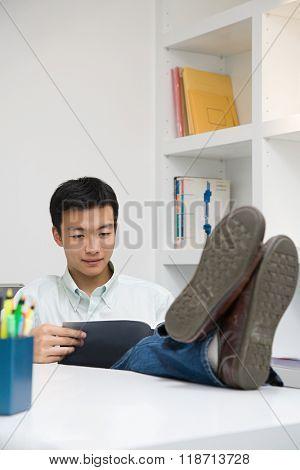 Man with feet on desk