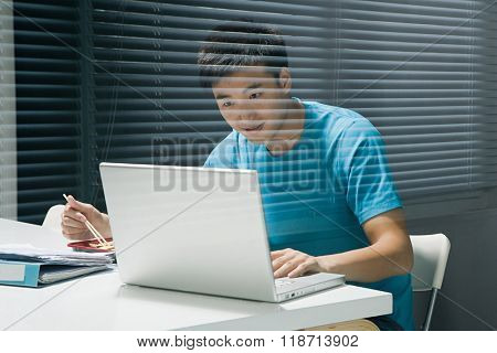 Man on laptop with takeaway