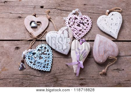 Different Decorative  Hearts On  Vintage Wooden Background.