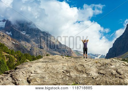 Young woman doing morning fitness outdoor in mountain landscape