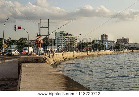 Man Fishing On The Pier For Fresh Fish