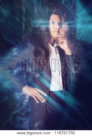 Three Quarter Length Portrait of Thoughtful Young Business Woman Wearing Suit Standing with Hand on Chin in front of Black Background with Graphic Technological Overlay