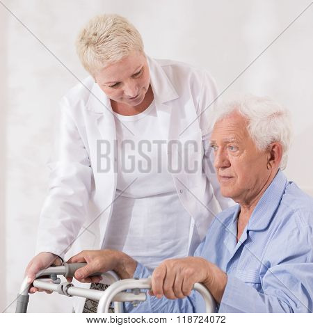 Disabled Patient With Walking Zimmer