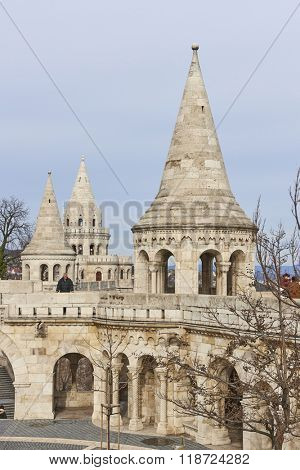 BUDAPEST, HUNGARY - FEBRUARY 02: Tourists walking around Fisherman's Bastion spires, one of the attractions at the Old Town district. February 02, 2016 in Budapest.