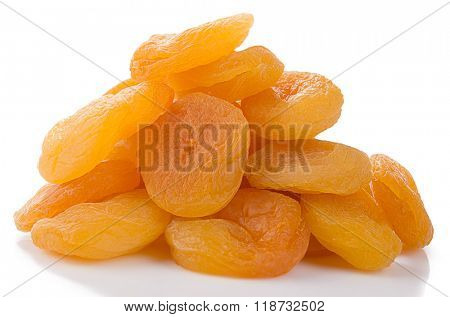Heap of dried apricots on white background.