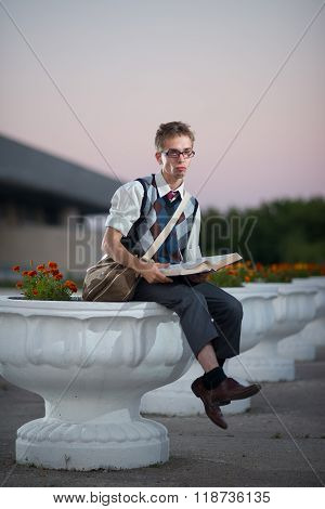 Comic Nerd With Glasses And A Book