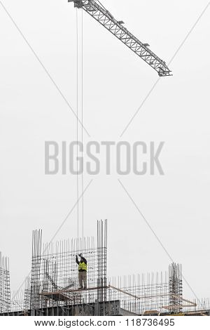 Man Working On Scaffold. Man Worker Working On Scaffold On Cold Winter Time, White Icy Sky, Part Of