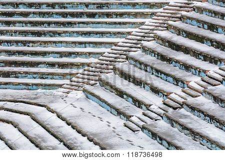 Old Amphitheater Texture Covered By Snow. Amphitheater Background Seats Covered By Snow In Winter, H