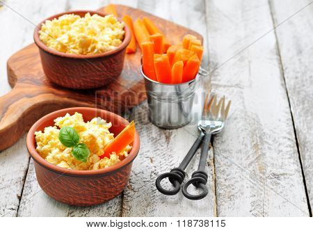 Dip cheese with egg and carrot sticks