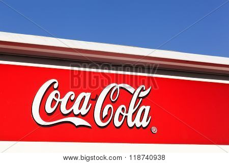 Coca Cola sign on a wall