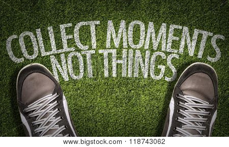 Top View of Sneakers on the grass with the text: Collect Moments Not Things