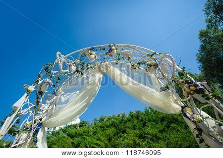 Wedding Archway With Flowers Arranged For A Wedding Ceremony