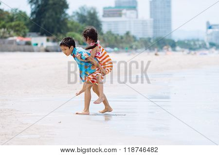 Boy Carry His Sister At His Back