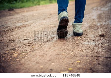 Woman Traveller Walk On The Dirty Road.