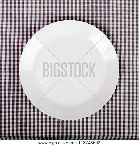 white plate on checkered table cloth