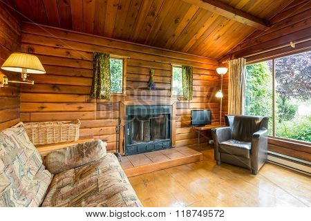 Cozy interior of a rustic log cabin.