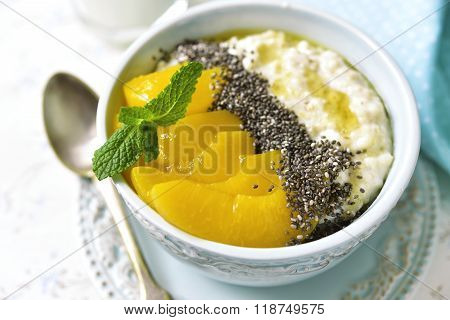 Oat Porridge With Chia Seed,canned Peaches And Honey.