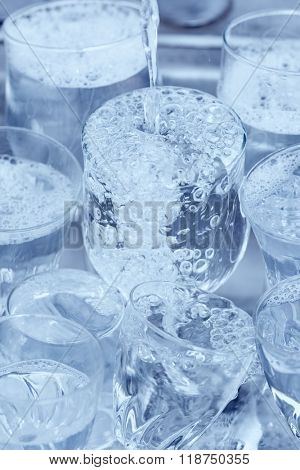 Dishwashing - Glassware under a water jet in the kitchen sink