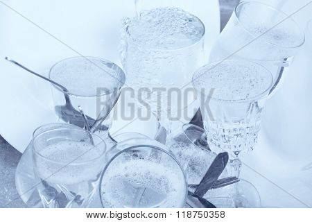 Dishwashing - Glassware,cutlery and dishes in the kitchen sink