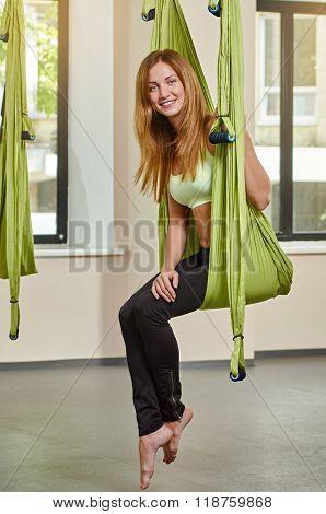 sitting portrait woman in anti-gravity aerial yoga
